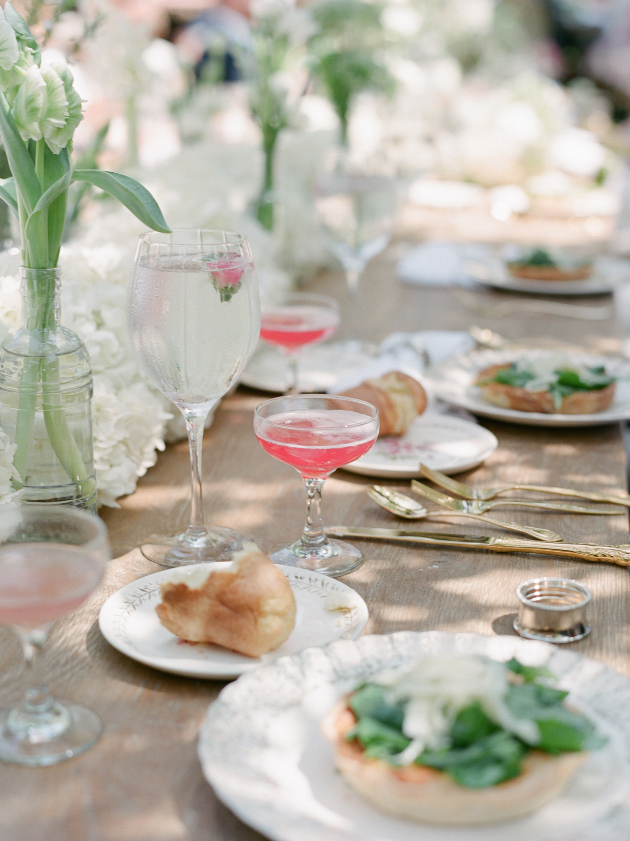 A bridal brunch gathering food at place setting