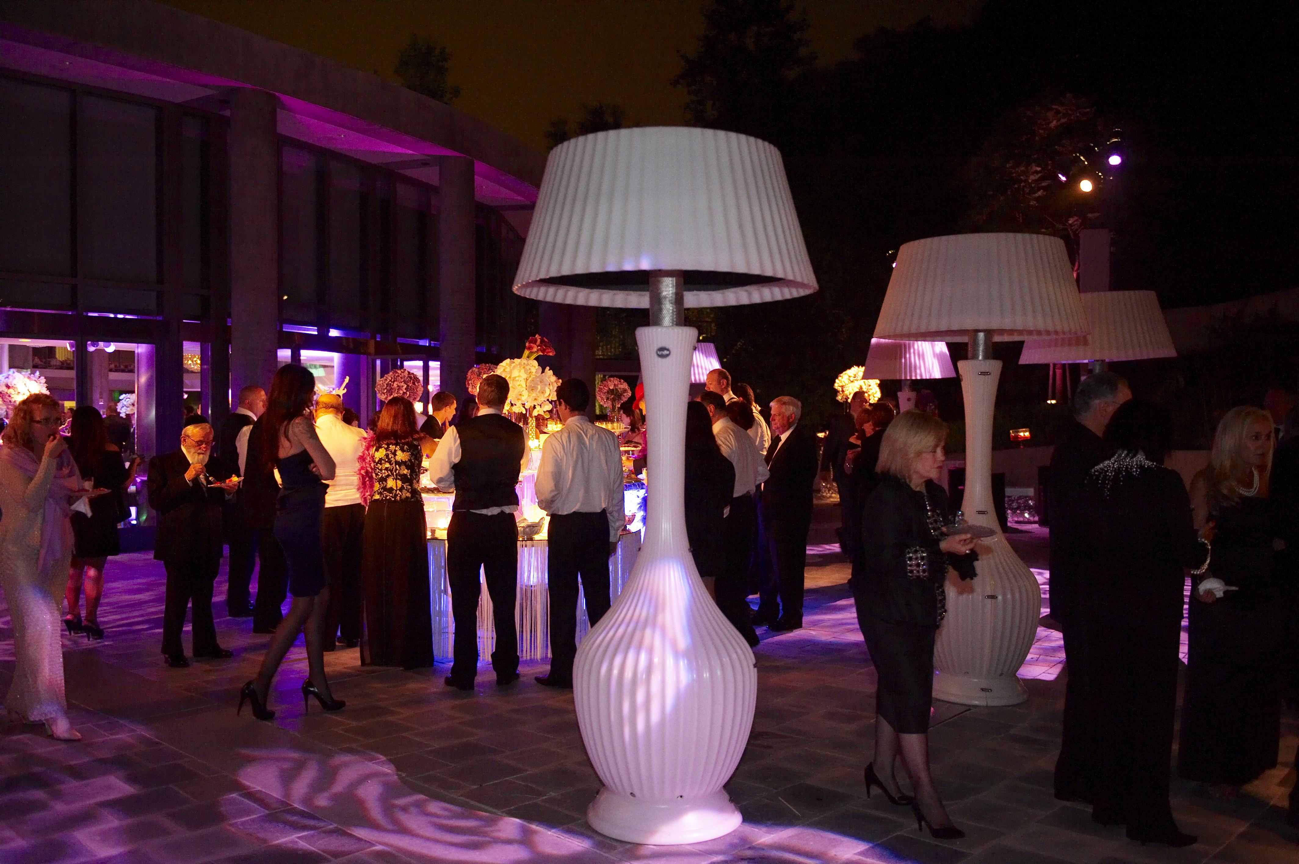 Large white lamp heater at outdoor wedding