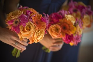bridesmaids-carrying-pink-and-orange-nosegays
