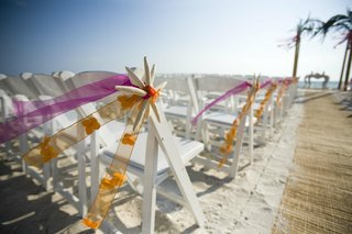 white-chairs-on-sand-decorated-with-starfish