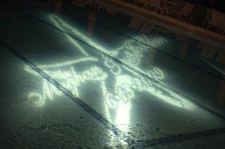 starfish-and-wedding-date-illuminate-bottom-of-pool