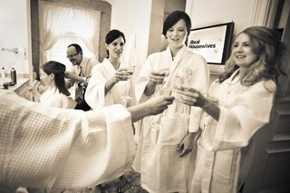 black-and-white-photo-of-bridesmaids-in-robes-cheersing