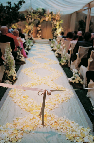white-aisle-runner-decorated-with-white-and-yellow-rose-petals