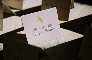 place-card-with-a-golden-old-english-monogram-and-script-font