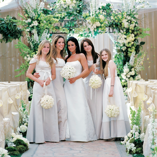 bride-with-females-wearing-long-off-white-dresses