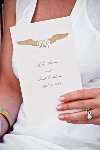 ceremony-booklet-with-wing-monogram-motif