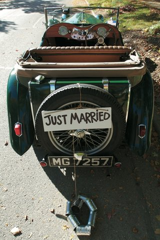just-married-sign-and-cans-on-back-of-antique-car