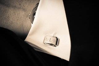 black-and-white-photo-of-cuff-link-with-groom-initials