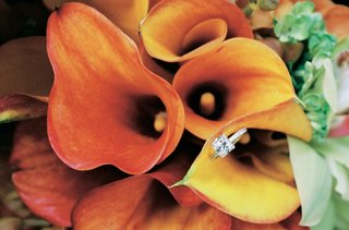 princess-engagement-wedding-ring-on-orange-calla-lily