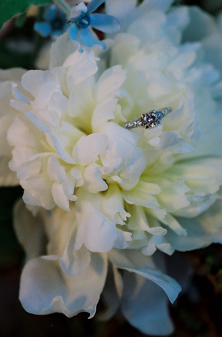 engagement-ring-on-top-of-white-flowers