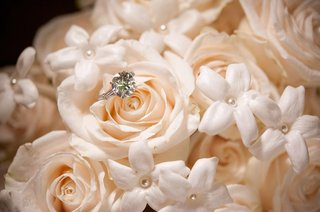 sparkling-diamond-ring-on-peach-rose-and-stephanotis-with-pearls