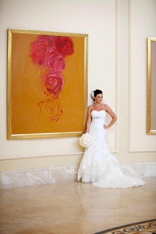 rosa-clara-bridal-gown-next-to-framed-painting
