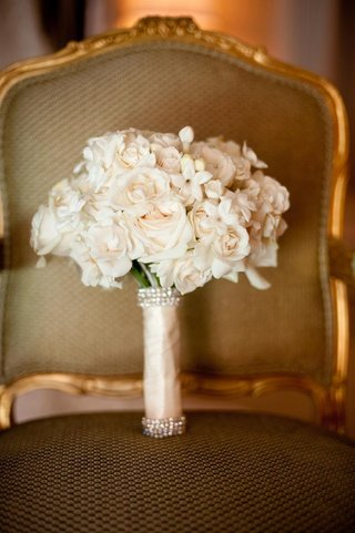 white-roses-and-stephanotis-blossoms-in-crystal-wrap