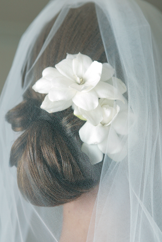 brides-low-bun-with-two-gardenias-and-veil
