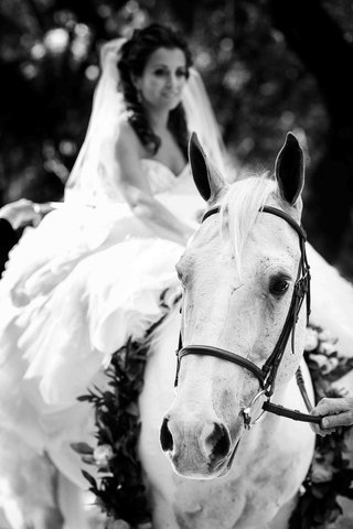 black-and-white-photo-of-bride-on-horseback
