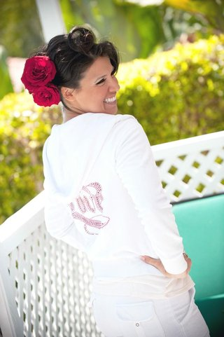 bride-in-sweatsuit-with-roses-in-hair