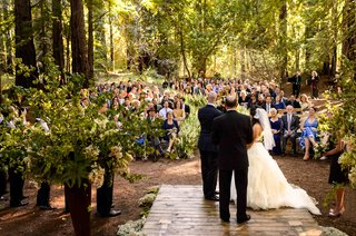 bride-and-groom-on-wood-plank-at-forest-redwood-ceremony