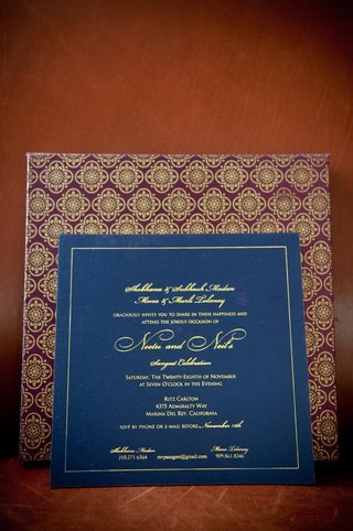 indian-floral-motif-on-purple-and-gold-envelope