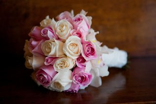 ivory-and-blush-roses-and-orchids-wrapped-in-white