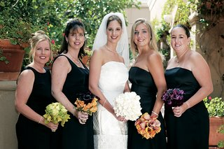 bridesmaids-with-mismatched-dresses-and-bouquets