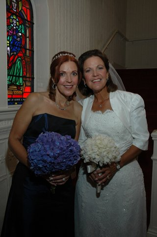 twin-bride-and-bridesmaid-at-church-ceremony