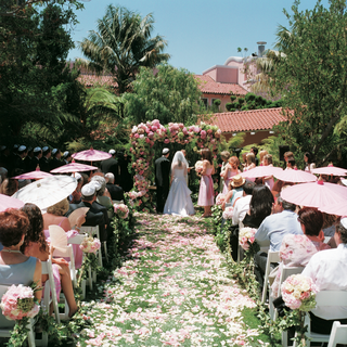 pink-and-white-rose-and-hydrangea-flowers-decorate-outdoor-ceremony