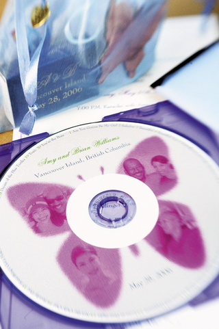 personalized-wedding-cd-decorated-with-a-pink-butterfly-and-photos-of-the-bride-and-groom