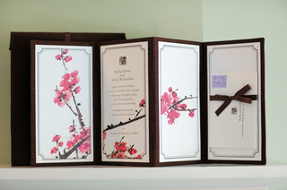 white-and-black-invitations-with-pink-cherry-blossom-pattern