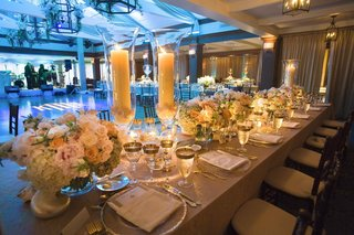neutral-wedding-tablescape-with-blue-lighting-on-dance-floor