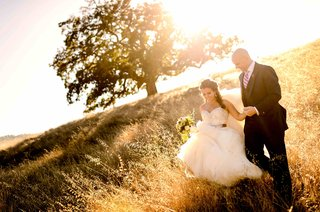 woman-in-ball-gown-walking-with-man-in-tuxedo