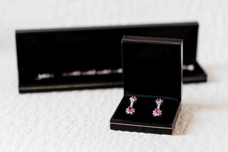 diamond-and-pink-sapphire-bracelet-and-earrings-in-black-boxes