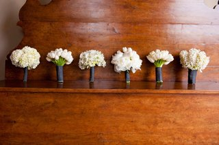 white-single-variety-bouquet-wrapped-in-black-ribbon