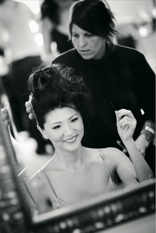 black-and-white-photo-of-stylist-arranging-brides-hair