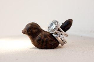 wedding-rings-on-brown-bird-ring-holder