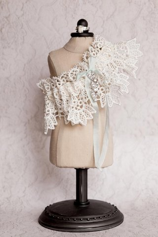 wedding-day-garter-on-mini-dress-stand-with-light-blue-ribbon