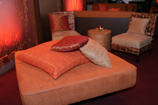 lounge-area-with-seats-and-ottomans-with-pillows