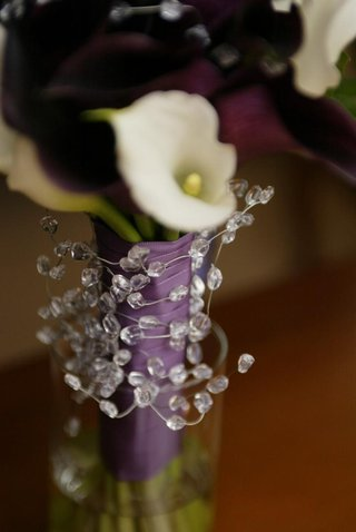 calla-lilies-tied-with-purple-ribbon-and-crystals