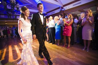 bride-and-groom-make-entrance-into-wedding-reception