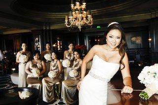 asian-american-women-in-hotel-lounge-in-scoop-dresses