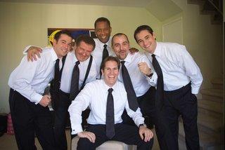 groom-with-groomsmen-in-grooms-suite