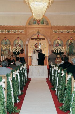 church-wedding-aisle-green-vine-decorations