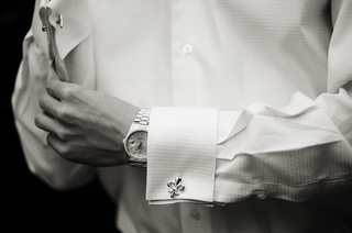 black-and-white-photo-of-groom-wearing-fleur-de-lis-cufflink-and-watch