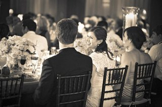 black-and-white-photo-of-bride-and-groom-at-head-table