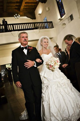 father-of-bride-walks-bride-down-chapel-aisle