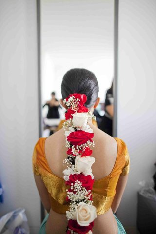 brides-braided-hair-with-red-and-white-flowers