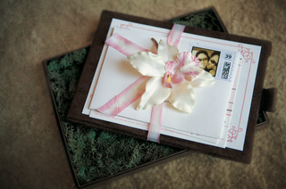 brown-and-white-invitations-tied-with-pink-ribbon-and-white-flower