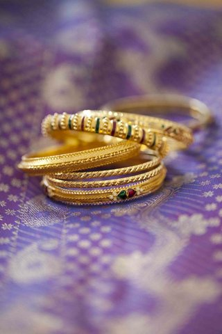 golden-bangles-with-red-and-green-enamel-touches