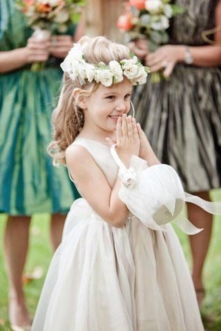 flower-girl-in-ivory-ball-gown-with-white-basket-and-headband