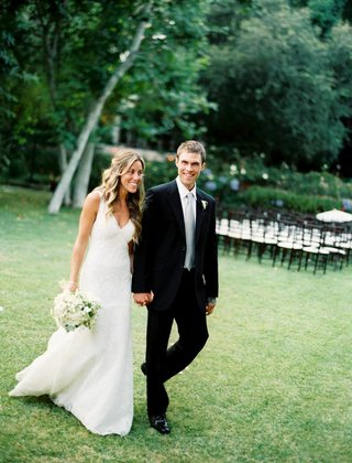 bride-in-a-monique-lhuillier-gown-and-groom-in-a-black-tuxedo-with-light-grey-tie