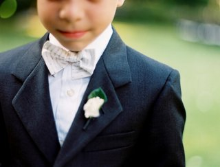ring-bearer-in-a-dark-suit-and-light-bow-tie